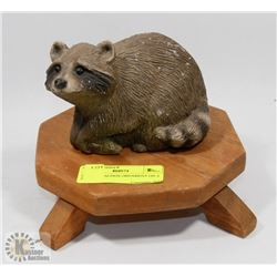 CEMENT RACOON ORNAMENT ON A STAND