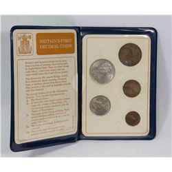 BRITISH FIRST DECIMAL COIN SET IN DISPLAY.