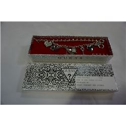 NEW IN BOX GUESS SILVER BRACELET W/ 8 CHARMS