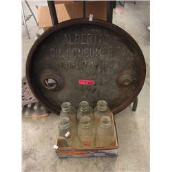 Cast Iron Oil Barrel Lid & 6 Glass Milk Bottles