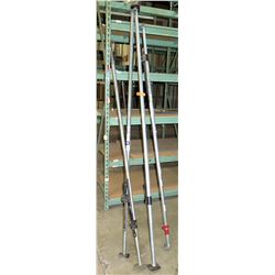 "Qty 4 Tall Adjustable Footed Poles, approximately 100""L"