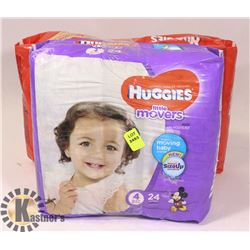 TWO PACKS OF HUGGIES DIAPERS