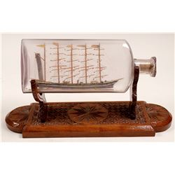 Ship in a Bottle with Wood Cradle   (106508)