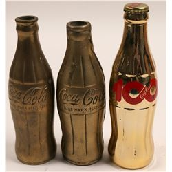 Coca Cola Bottles / 2 Brass & A Centennial / 3 Items.   (102153)
