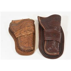 Two Leather Tooled Small Pistol Holsters