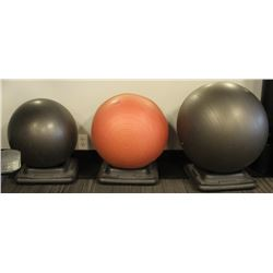 LOT OF 3 EXERCISE BALLS WITH STANDS