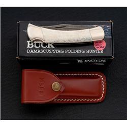 Scarce Damascus Buck 110 Folding Knife