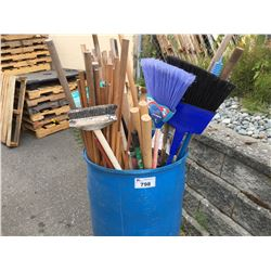 BLUE BARREL FILLED WITH ASSTED DOWELS, WOOD TRIM, BROOMS ETC