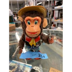VINTAGE TIN WIND UP MONKEY SHERIFF