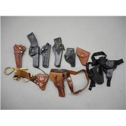ASSORTED BLACK AND BROWN LEATHER HOLSTERS