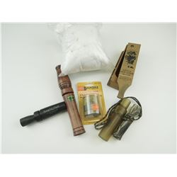 ASSORTED ANIMAL CALLS AND MESH GAME BAGS.