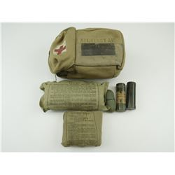 MILITARY FIRST AID KIT, AND FIELD DRESSINGS.