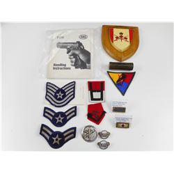 CANADIAN REGIMENTAL PLAQUE, ASSORTED MILITARY PATCHES, BADGES AND RIBBONS, AND HANDLING INSTRUCTIONS