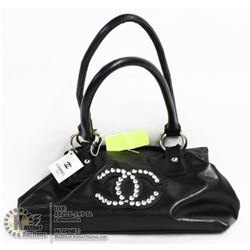 REPLICA CHANEL BLACK BAG WITH JEWELLED LOGO.