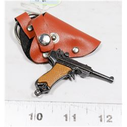 1950S LUGER CAP GUN KEYCHAIN WITH HOLSTER.