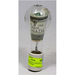 VINTAGE NOVELTY LIGHT BULB WITH $1 BILL INSIDE.
