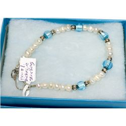"STERLING SILVER 7.5"" PEARL DICHROIC BEAD BRACELET."