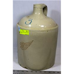 RED WING 3 GALLON JUG WITH CHIP ON BOTTOM.