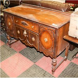 ANTIQUE BUFFET WITH ORNATE ACCENTS