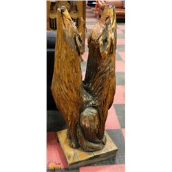 2 HOWLING WOLVES HAND CARVED FROM A SINGLE TREE