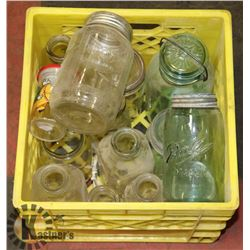 CONTAINER FULL OF ANTIQUE BLUE GLASS MASON JARS