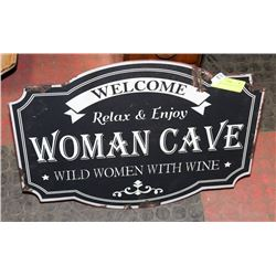LARGE METAL WOMAN CAVE SIGN