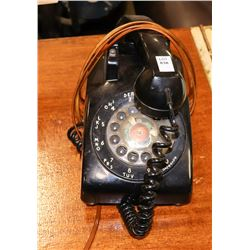 BLACK PLASTIC ROTARY DIAL TELEPHONE.