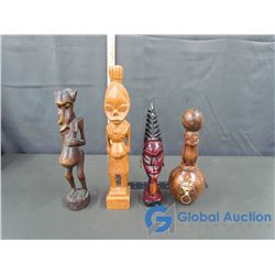 (3) Wooden Carved Statues and a Leather Covered Bottle