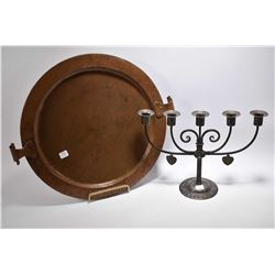 Antique iron five branch candelabra and a arts and craft copper charger with hand hammered scroll wo