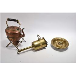 Antique copper spirit kettle on stand, a brass clock meat rotisserie and a brass candleholder