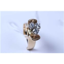 Lady's 14kt yellow gold and diamond ring set with three brilliant cut white diamonds