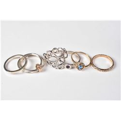 Selection of silver and gold rings including 10kt set with aqua gemstone, sterling gemstone set ring