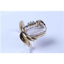 Lady's 10kt yellow gold ring set with free form genuine pearl and diamond accents