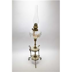 "Delicate colourless oil lamp in brass and marble holder, 29"" in height"