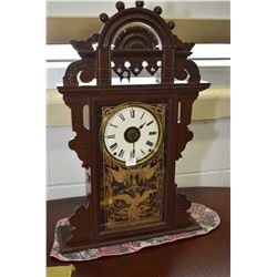 Eastlake style gingerbread chiming mantle clock with gold litho glass front featuring American eagle