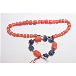 "Coral and stone bead necklace 22"" in length and a coral and blue beaded bracelet"