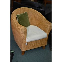 Two rolled wicker parlour/ tub chairs with thick upholstered seat cushions