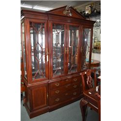 Large antique style modern mahogany break front cabinet with illuminated top section, mirrored back