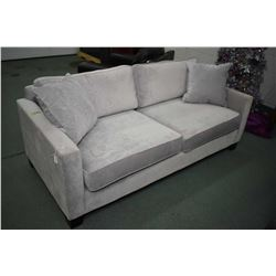 Canadian made condominium sized sofa with grey upholstery made by Urban Barn and includes two matchi