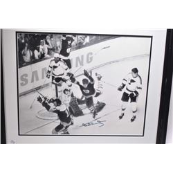 "Two framed sports pictures including Doug Weight ""Heading for the Top"" and a Bobby Orr action shot"