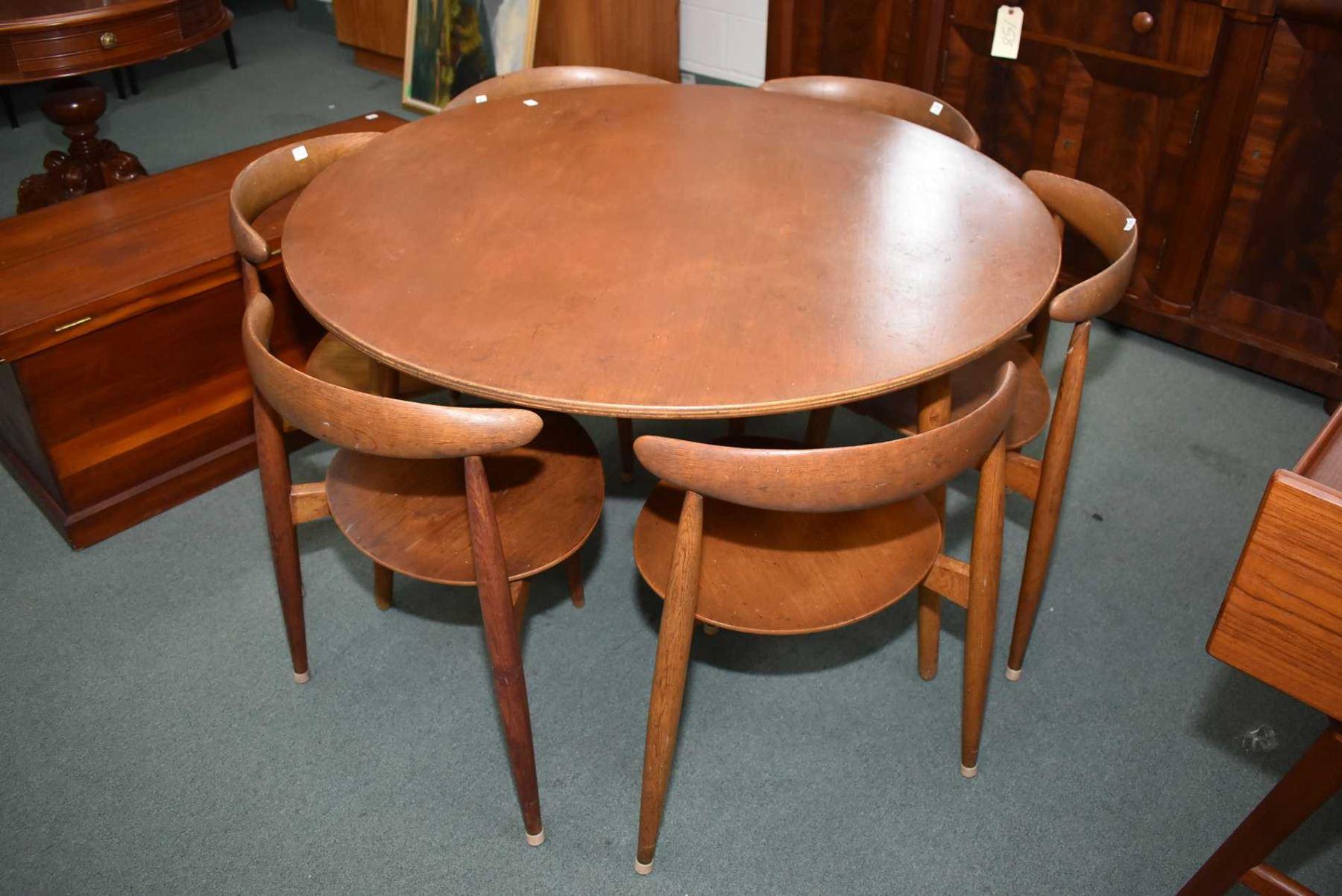 Mid century modern round dining table with six, three legged ...