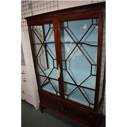 Antique mahogany two door display cabinet with under storage with robin's egg blue upholstered shelv