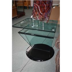 Jazz model rotating glass television stand made by Reflex, originally retailed for $4,050.00