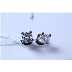 Lady's 14kt white gold and diamond stud earrings, set with 0.58ct of brilliant white round brilliant