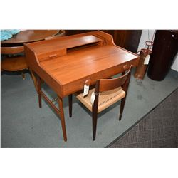 Danish made teak writing desk with single drawer galley and letter compartment plus two drawers in m