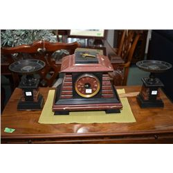 Art deco three piece red and black marble chiming mantle clock and garniture set, trying to run at t