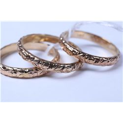Three matching 14kt yellow gold embossed stacking bands