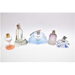 Selection of vintage antique glass perfume and atomizer bottles
