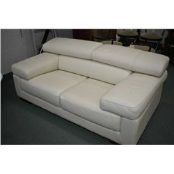 White leather loveseat with fold up head rest design originally purchased from Finese Furnishings