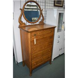 Five drive quarter cut oak, antique Canadiana mirrored highboy with carved claw feet